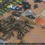 Boko Haram shows off weapons captured during raid in Yobe.